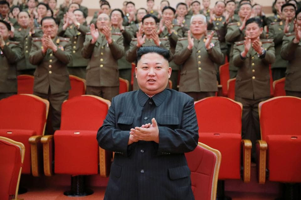 North Korean leader Kim Jong-Un (C) visiting the People's Theatre to mark the 70th anniversary of the founding of the State Merited Chorus in Pyongyang.  According to South Korean experts, Pyongyang has between 2,500-5,000 tonnes of chemical weapons including nerve agent VX which was used to murder Jong Un's half brother Kim Jong Nam in Malaysia.