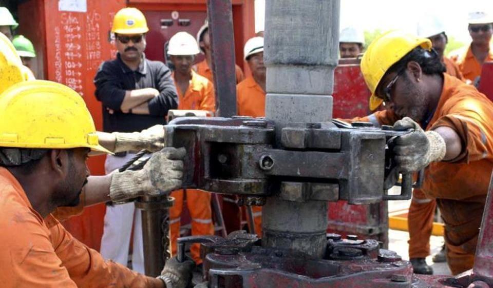 Engineers of ONGC work inside the Kalol oil field in Gujarat.