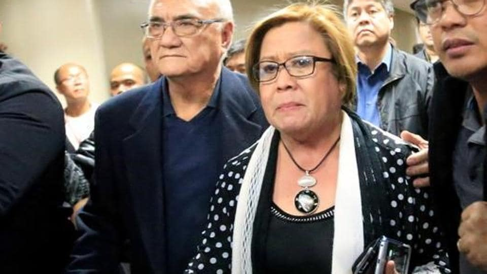 Philippine senator Leila de Lima being escorted by the senate's security personnel after a court ordered her arrest, in Manila.