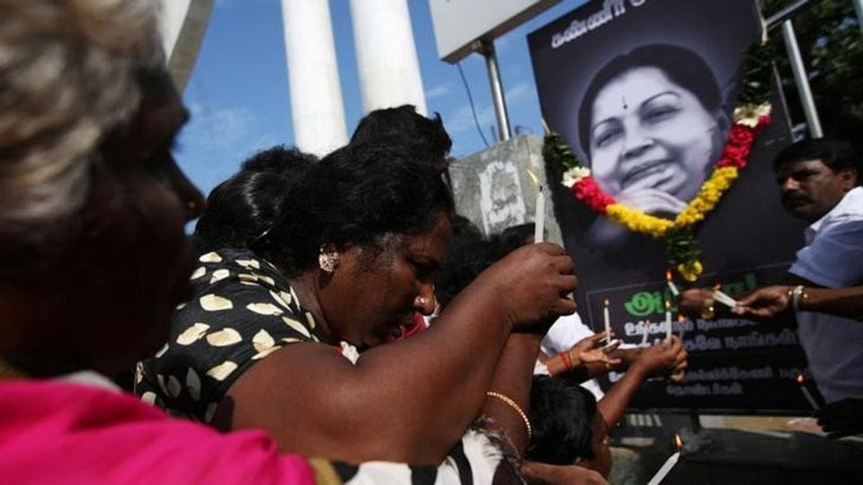 Supporters of Tamil Nadu chief minister Jayalalithaa Jayaraman light candles in front of her picture as they pay homage outside Jayalalithaa's burial site in Chennai, India, December 7.