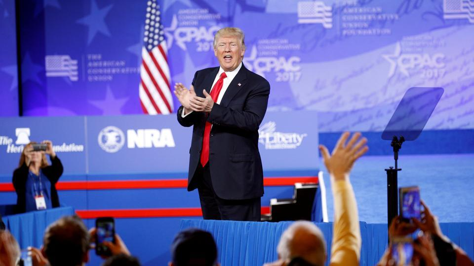 US President Donald Trump applauds his supporters after speaking at the Conservative Political Action Conference, or CPAC, in Oxon Hill in Maryland.