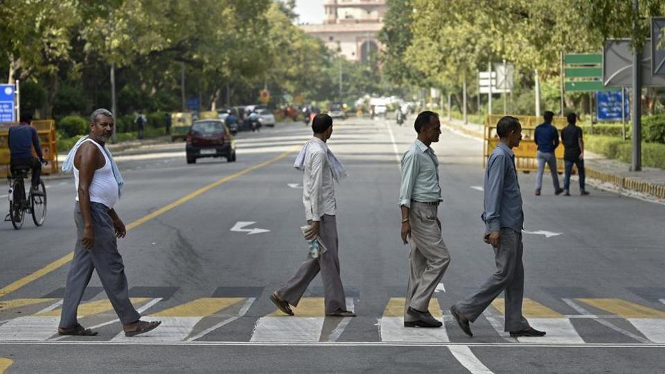 People cross a 3D zebra Crossing at Rajaji Marg in New Delhi on Thursday.