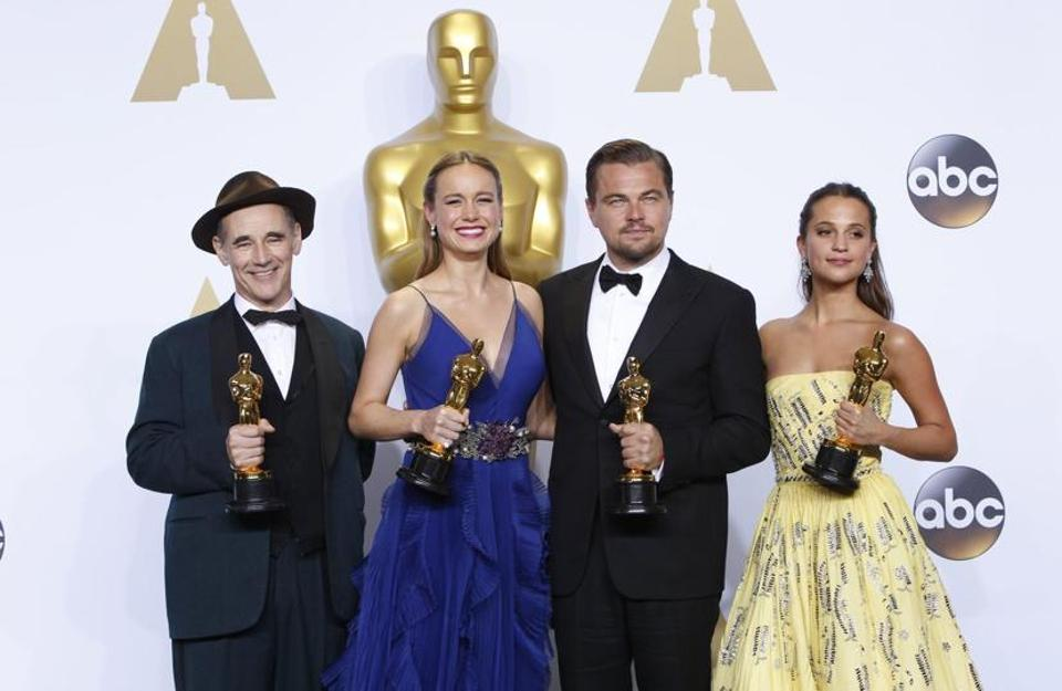 (From left) Actors Mark Rylance, Brie Larson, Leonardo DiCaprio and Alicia Vikander pose in the press room during the 88th Annual Academy Awards in Hollywood, California, on February 28, 2016.