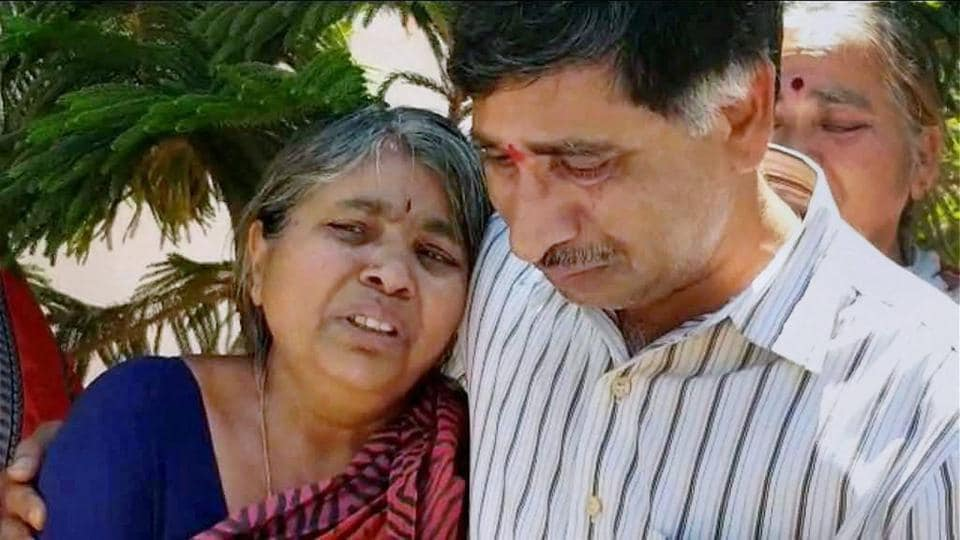 Parents of engineer Srinivas Kuchibhotla mourn his death in Hyderabad on Friday. Kuchibhotla was killed in a shooting at a bar in Kansas.