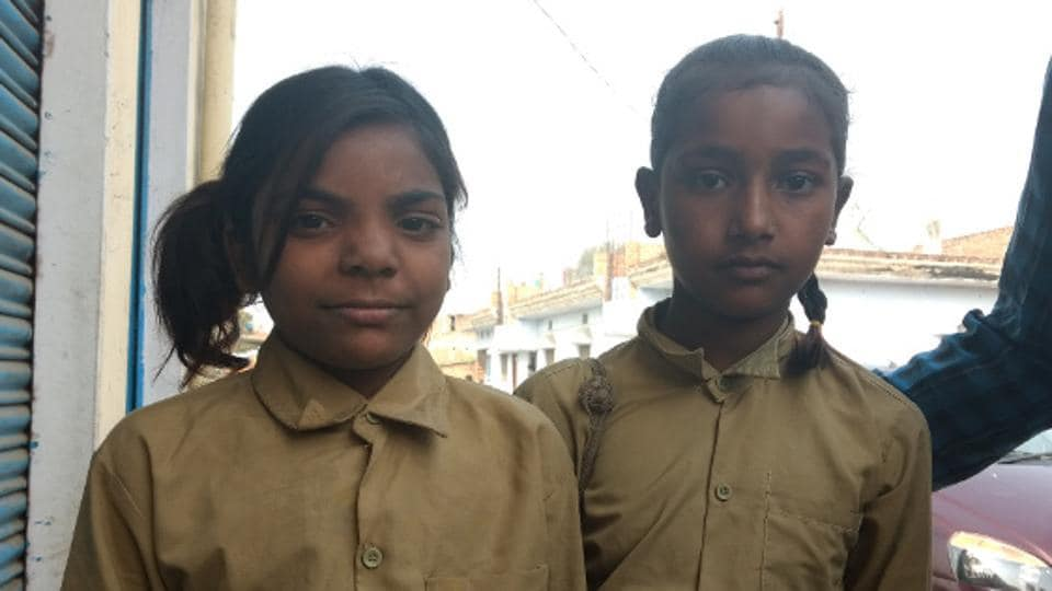 Saidun Ahmed (left) on her way to school in Fattepur village, Mirzapur district in eastern Uttar Pradesh, said she couldn't read well. Poor quality education and high absenteeism plague government schools in the state.