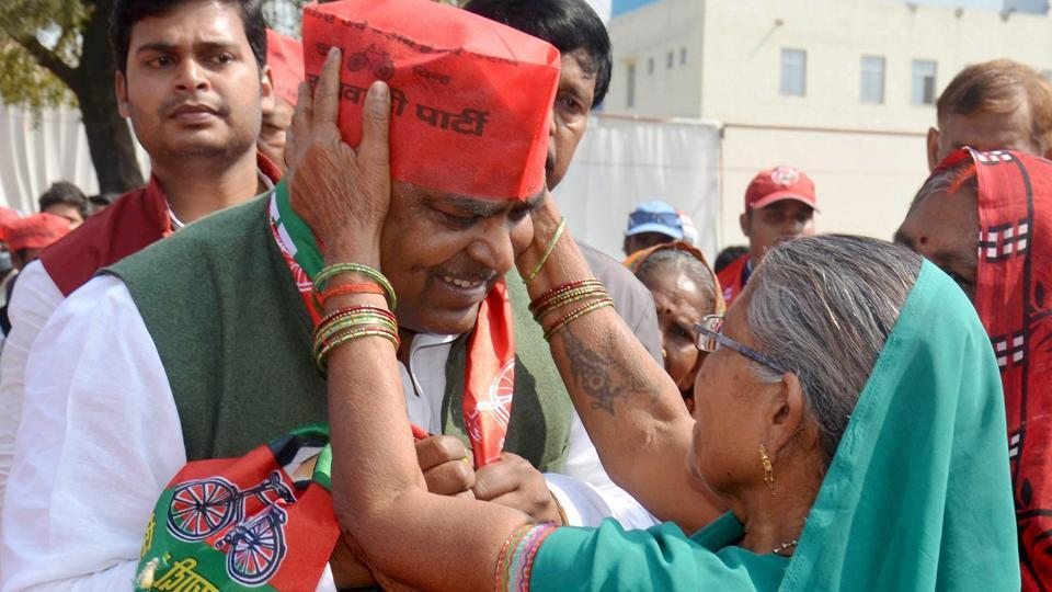 SP candidate from Amethi and minister Gayatri Prajapati is greeted by supporters during an election rally in Amethi.