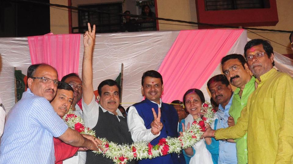 Union minister Nitin Gadkari (centre, left), Maharashtra CM Devendra Fadnavis and party MLAs celebrate the BJP's victory in Nagpur.