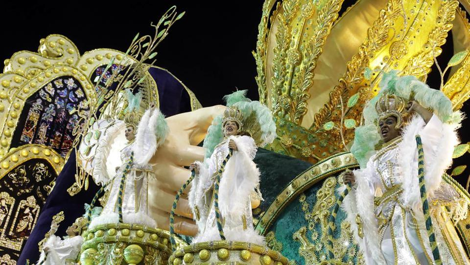Dancers from the Vila Maria samba school perform on a float. (Andre Penner/AP)
