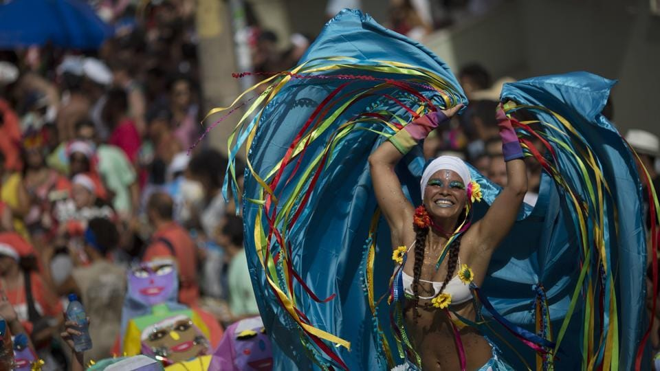 A reveler performs during the Carmelitas street party in Rio de Janeiro, Brazil. (Leo Correa/AP)