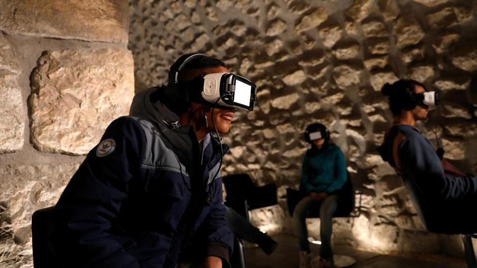 Visitors wear headsets as they experience a virtual reality tour depicting Jerusalem as it was two millennia ago, at a visitors centre near some of the world's most sacred sites holy to Jews, Muslims and Christians, in Jerusalem's Old City. (Ronen Zvulun/REUTERS)
