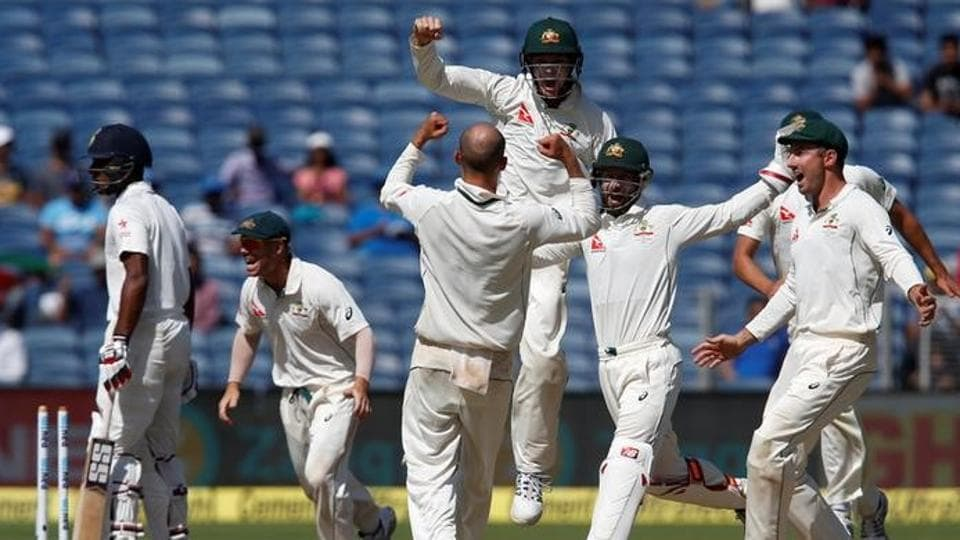 Australia's players celebrate after winning the match against India in Pune.