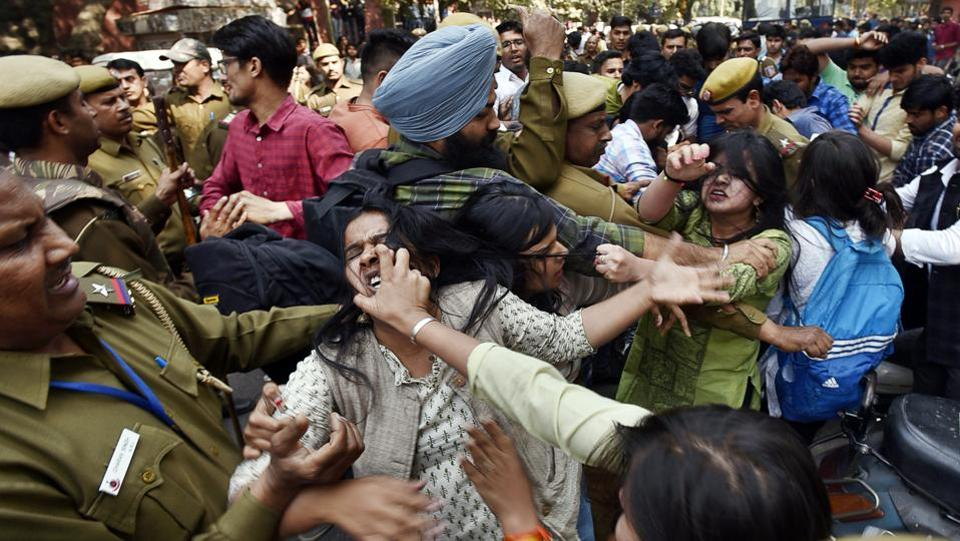 ABVP and AISA members fight during a clash over Ramjas College's literary festival at North campus, Delhi University. (Raj K Raj/HT PHOTO)