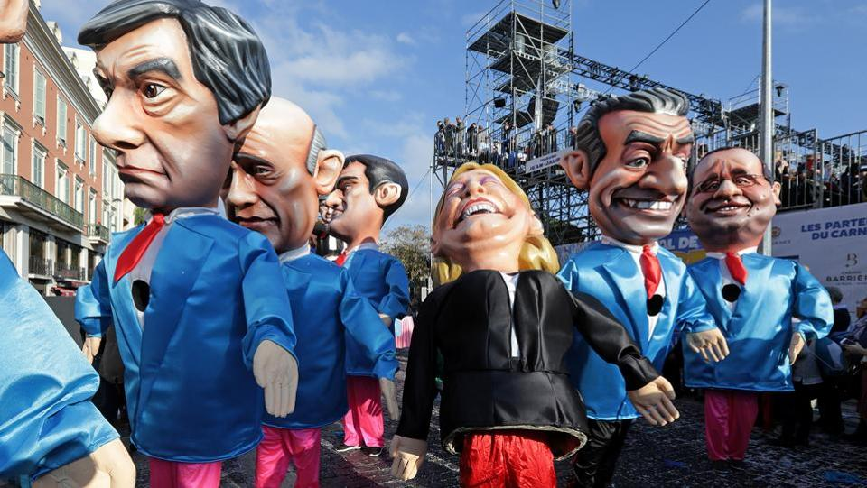 Figures of former French Prim Minister Francois Fillon (L), member of The Republicans political party and 2017 presidential candidate of the French centre-right, French National Front leader Marine Le Pen (C) and former French President Nicolas Sarkozy (R) are paraded through the crowd during the Carnival parade of the 133rd carnival, the first major event since the city was attacked during Bastille Day celebrations last year in Nice, France. (Eric Gaillard/REUTERS)