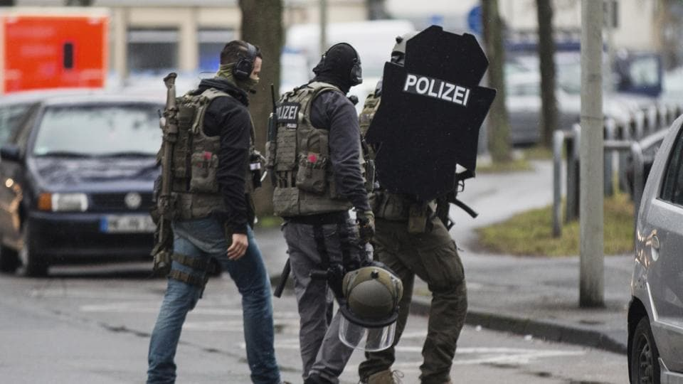 German police say a man apparently drove a vehicle into people in a central square in Heidelberg.