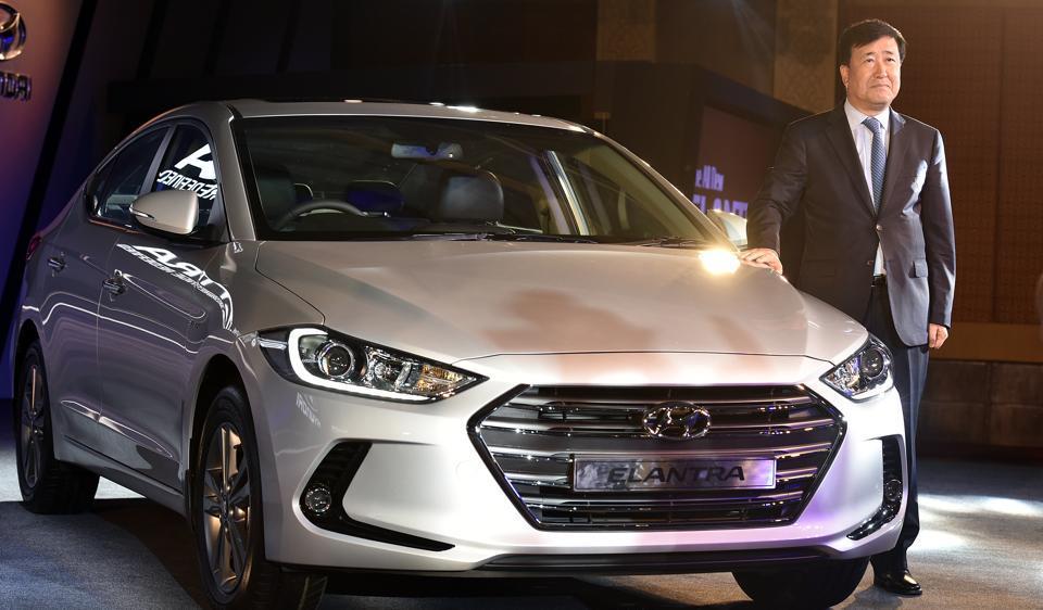 YK Koo, MD and CEO of Hyundia Motor India Ltd, poses with 2016 Hyundai Global Sedan All New Elantra.