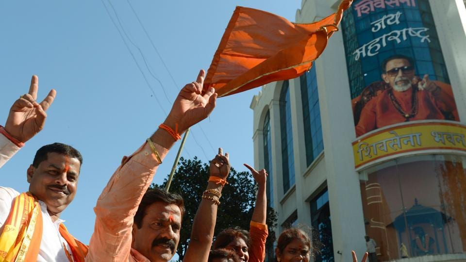 Members of the Shiv Sena party take part in a rally after victory in the Brihanmumbai Municipal Corporation (BMC) election in Mumbai on February 23.