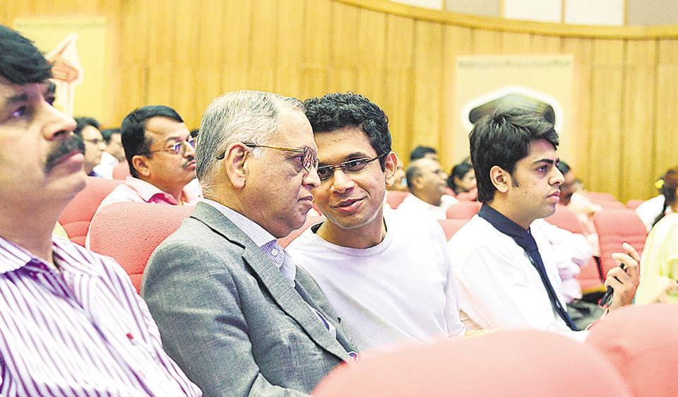 Founder of Infosys NR Narayana Murthy with son Rohan Murthy sitting among the investors during Infosys 34th Annual General meeting in Bengaluru.