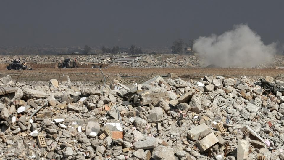 An Islamic State group mortar lands near Iraqi Army forces inside Mosul's international airport, in western Mosul, Iraq, Feb. 24, 2017. Iraqi forces pushed into the first neighbourhood in western Mosul on Friday and took full control of the international airport on the city's southwestern edge from the Islamic State group, according to Iraqi officials.