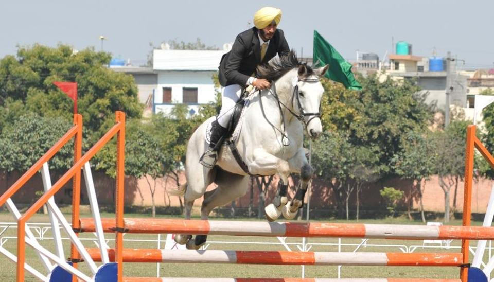 A horse rider participating in the national-level tent-pegging championship and Punjab Horse Show in Jalandhar on Friday.