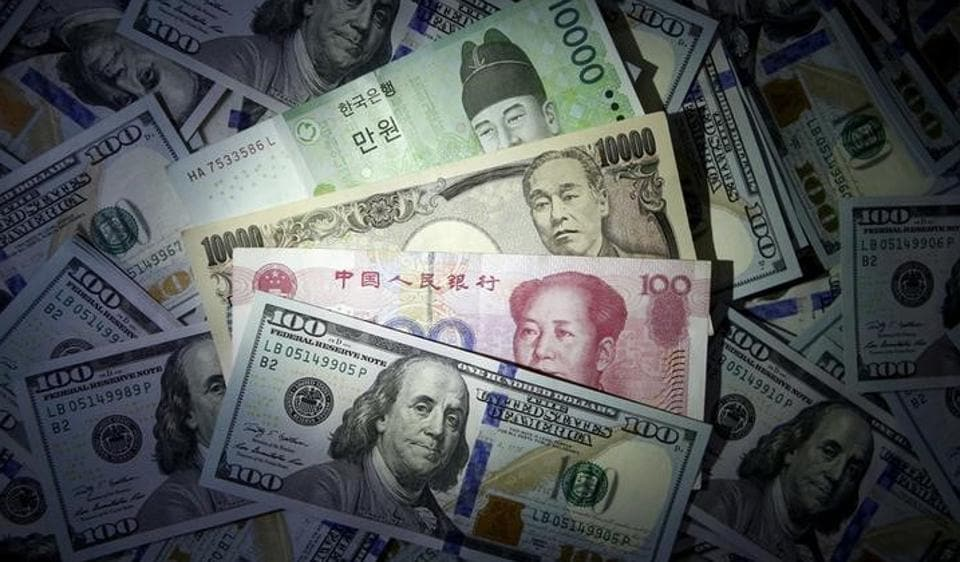 South Korean won, Chinese yuan and Japanese yen notes are seen on US 100 dollar notes in this file photo.