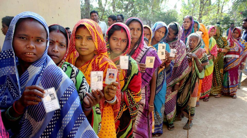 Voters stand in the queue during the last phase of Odisha's panchayat election, Khurda district, February 21.