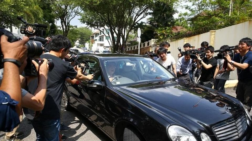 Members of the media surround a North Korea official's car as it leaves the North Korea embassy, following the murder of Kim Jong Nam, in Kuala Lumpur, Malaysia, February 23.