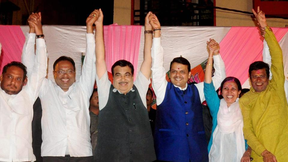 Union minister Nitin Gadkari (third from left) along with Maharashtra chief minister Devendra Fadnavis (third from the right) along with party MLAs celebrate the municipal corporation poll results, Nagpur, February 24.