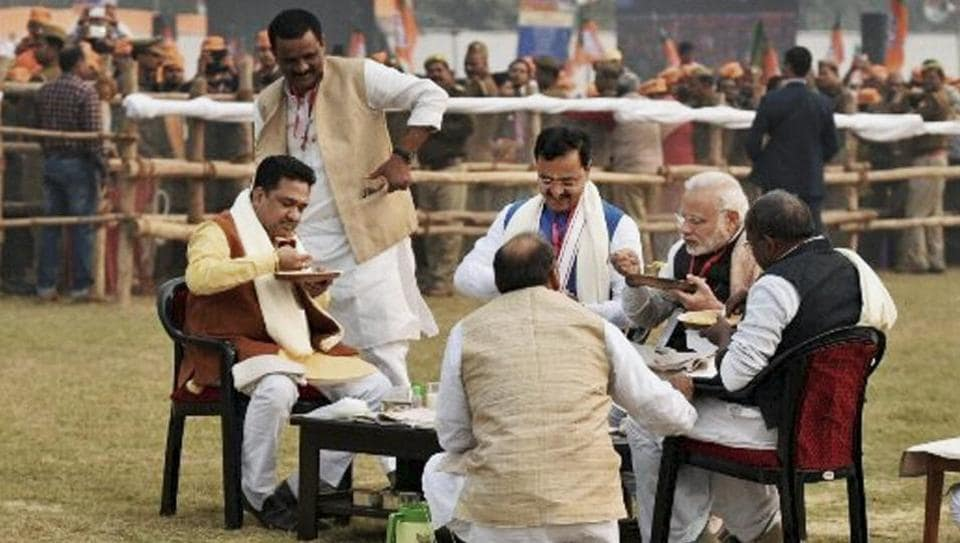 Prime Minister Narendra Modi seen having lunch with Sunil Bansal (in brown jacket) and a few other party workers at a meeting in Varanasi late last year.