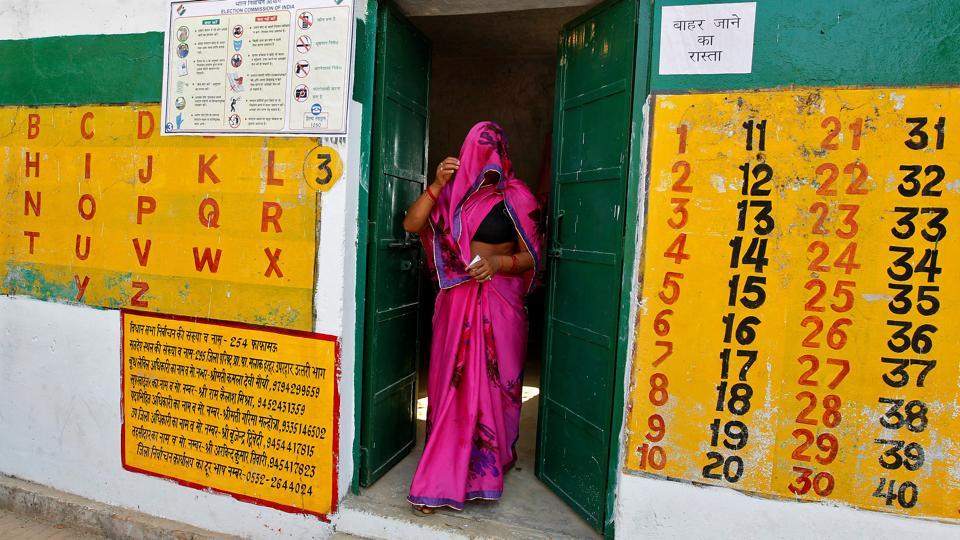 A woman leaves after casting her vote at a polling station during the fourth phase of the state assembly election in Allahabad, India (Jitendra Prakash/REUTERS)
