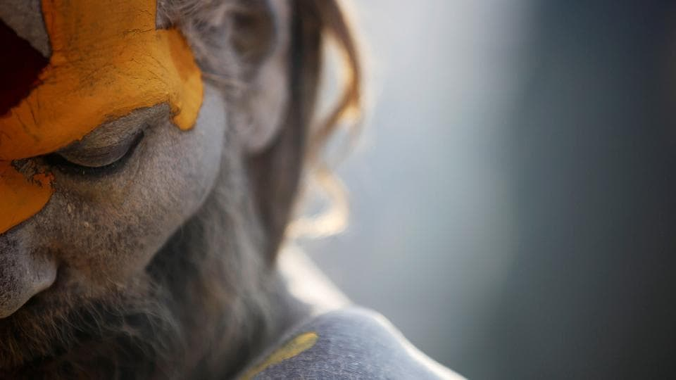 A Hindu holy man, or sadhu, smeared with ashes is pictured as he sits at the premises of Pashupatinath Temple during the Shivaratri festival in Kathmandu, Nepal. (Navesh Chitrakar/REUTERS)