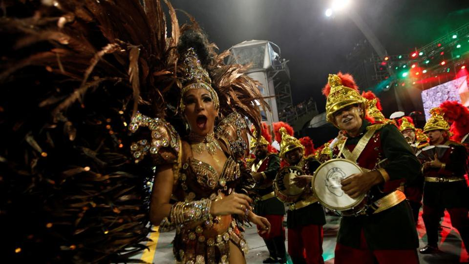 Revellers parade for the Mocidade Alegre samba school during the carnival in Sao Paulo, Brazil. (Paulo Whitaker/REUTERS)