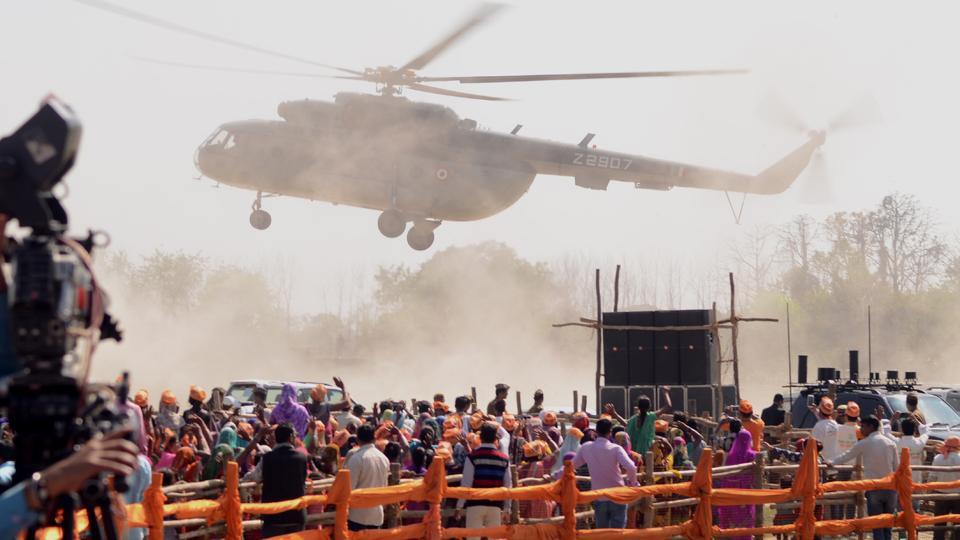 A helicopter flies over the crowd during Prime Minister Narendra Modi's election rally in Bahraich, Uttar Pradesh. ((HT Photo))