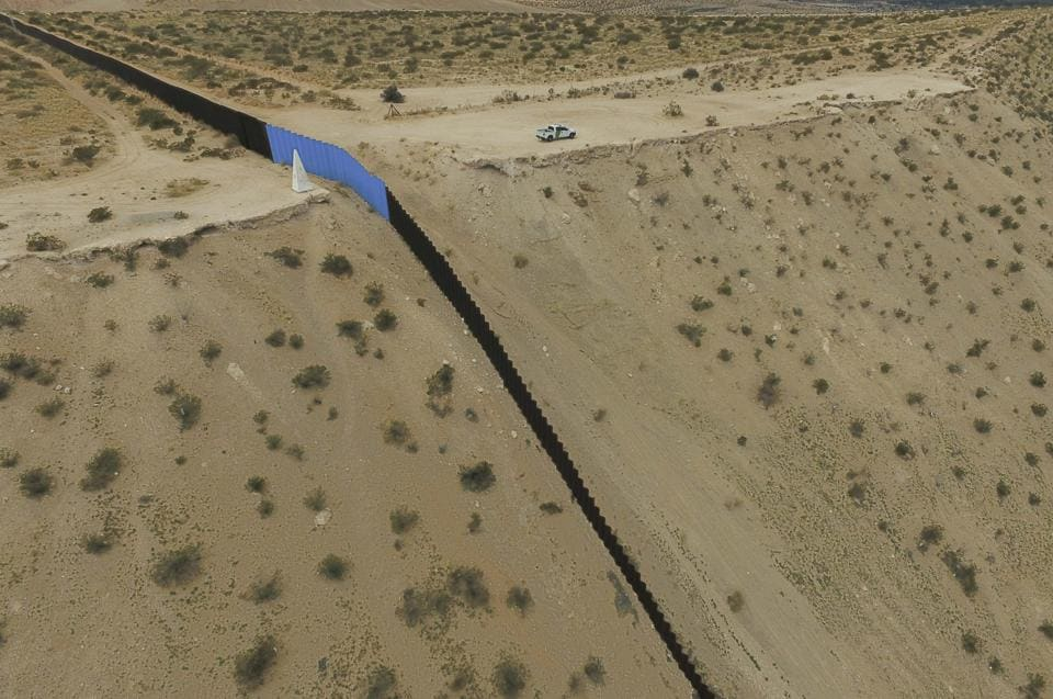 Aerial view of the metal fence between Mexico (L) and the United States (R) taken in Puerto Anapra, Chihuahua state. (Yuri Cortez/AFP)