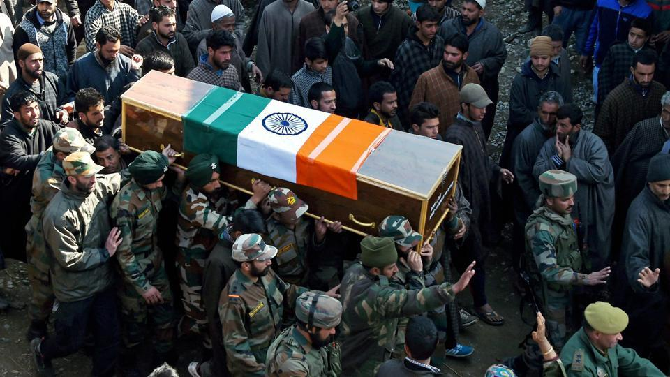 Army officers carry the body of Ghulam Mohi- Ud-Din Rather for his funeral in his native Panjpora village on Friday.