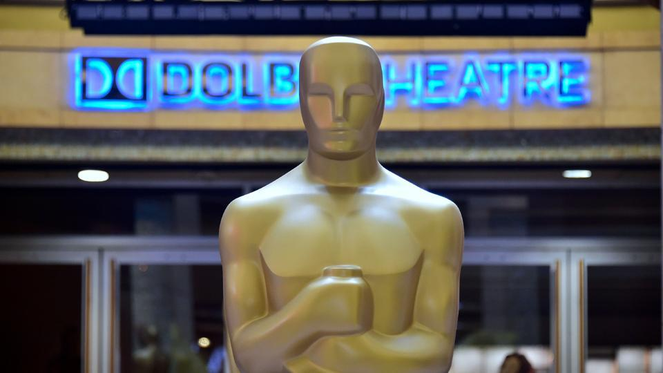 Oscar statues stand in front of the Dolby Theater . (AFP)