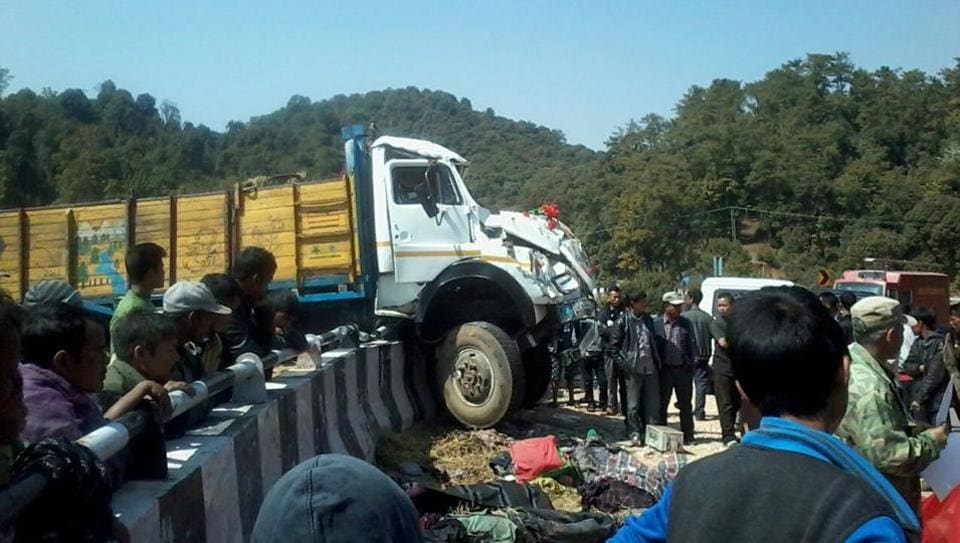The driver lost control of the truck and hit a concrete railing on the hilly road – throwing most of the passengers in the back down a deep gorge.
