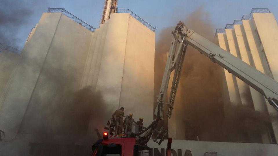 Firemen douse flames at the Times of India building in Bahadur Shah Zafar Marg.