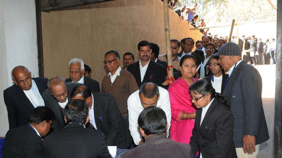 Lawyers proceeding to cast their vote during the annual election of Ranchi District Bar Association at Civil court premises in Ranchi on Saturday