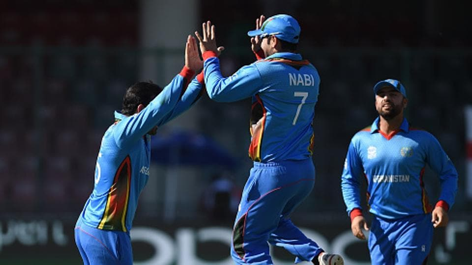 Mohammad Nabi took three wickets as Afghanistan beat Zimbabwe in Harare.
