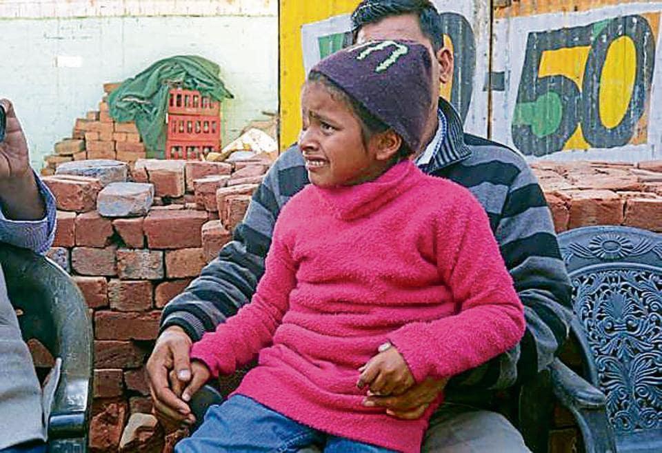 Diya Sharma, daughter of deceased Ramesh Kumar Sharma, in Ludhiana on Sunday.