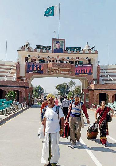 Members of a Hindu 'jatha' entering the Indian side from the Attari Border in Amritsar on Sunday.