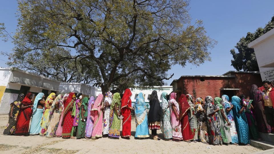Women stand in a queue to cast their votes at a polling station on the outskirts of Allahabad, Uttar Pradesh.
