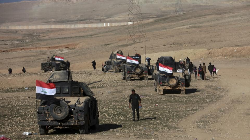 Iraqi security forces advance during fighting against Islamic State militants in the western side of Mosul, Iraq, Saturday, Feb. 25. 2017.