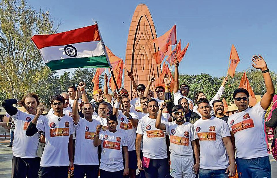 The team of runners with their supporters on their way to the Wagah border at the Jallianwala Bagh in Amritsar on Sunday.