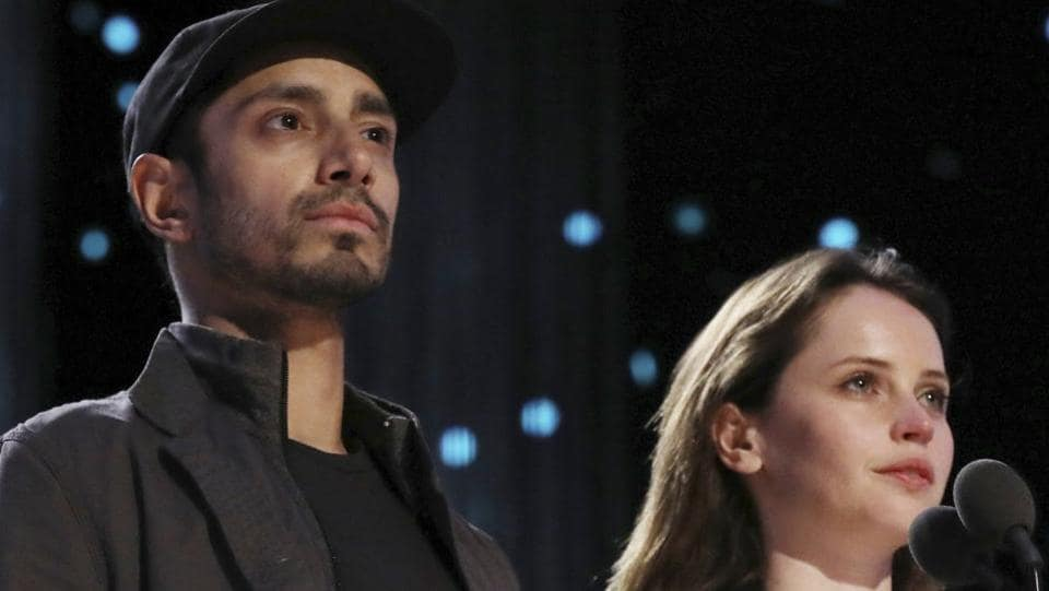 Riz Ahmed, left, and Felicity Jones take their duties seriously. (Matt Sayles/Invision/AP)
