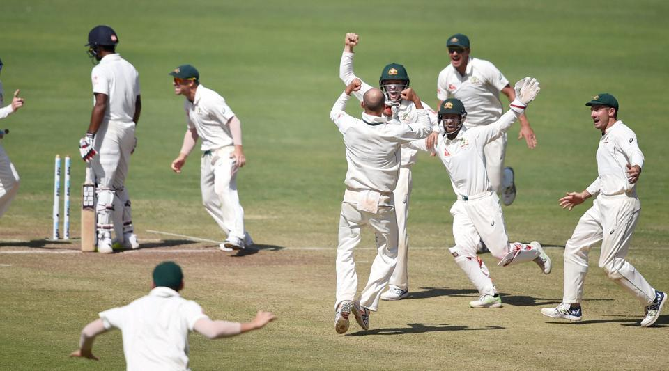 Australian cricket team players celebrate after defeating Indian cricket team in the first Test.