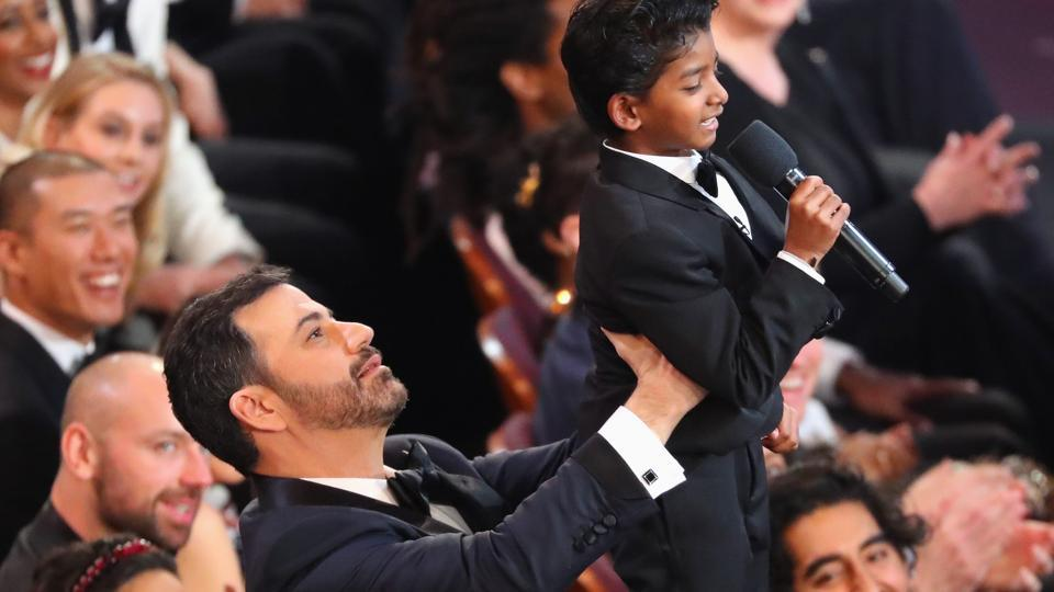 Jimmy Kimmel lifts Sunny Pawar during the 89th Academy Awards at the Dolby Theatre in Los Angeles on Monday.