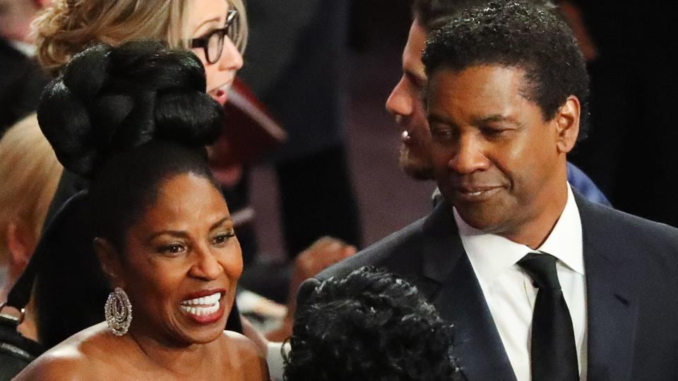 Actor Denzel Washington and wife Pauletta on the red carpet. (REUTERS)