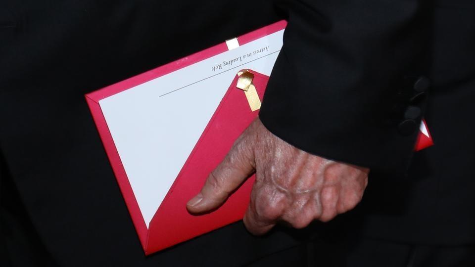 Presenter Warren Beatty holds the award envelope.