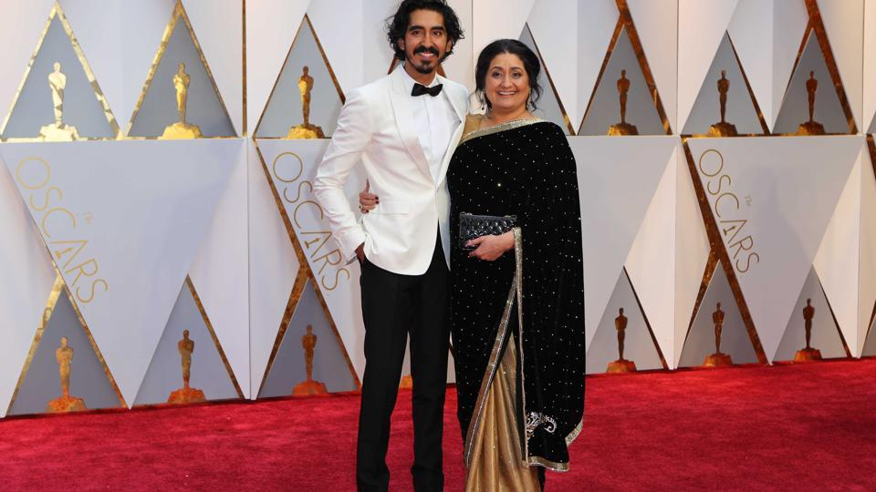 Actor Dev Patel with his mother Anita Patel on the red carpet at the Academy Awards 2017.